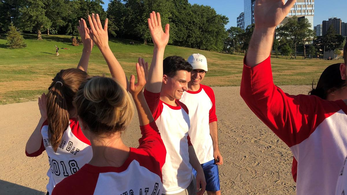 Photo - High Fives all Around - Toronto Annual Summer Student and Litigation Softball Tournament
